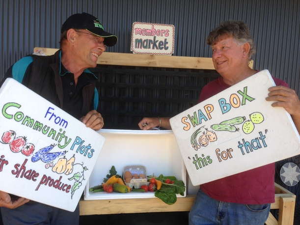 Mike and Ian contributed to the making of the Members Market. Here they are proudly showing some of the first produce contributions.